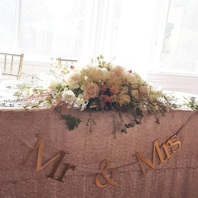 Head table arrangement from the talented Flowers by Maggie!