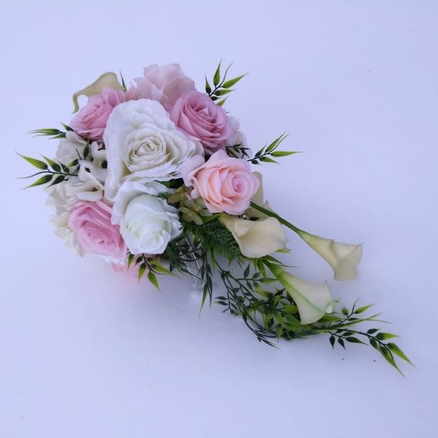 Stumning cascading artificial bouquet! cascadingbouquet artificialflowers expressionsbyme winterwedding